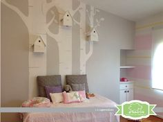 A pink and gray nursery with yellow accents featuring mixed patterned walls including polka dot and stripes.