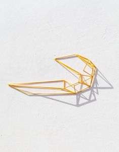 Yellow powdercoated steel sculpture byDion Horstmans. Photo -Phu Tang.