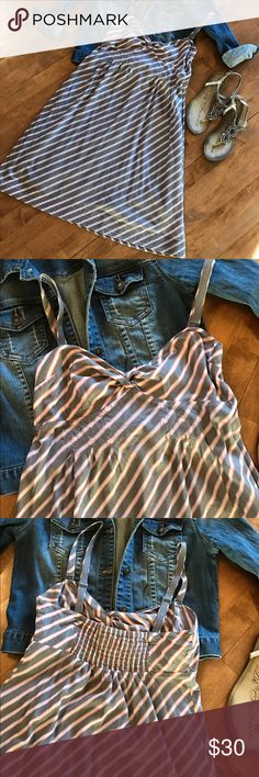 American Eagle Stripped Sundress Gray, white and orange stripped dress. Cotton lined. Adjustable spaghetti straps that can be removed entirely to make this a strapless dress!!! Elastic panel on back of dress for the perfect fit. Size 8,  fits like a medium. Great condition! No trades, 20% off bundles! American Eagle Outfitters Dresses