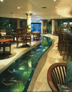 I want this in my house, lol. Custom 6000 gallon floor aquarium with attached 500 gallon saltwater window aquarium. River through the house. Located at Crustacean Restaurant in Beverly Hills.