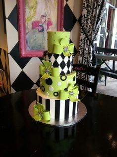 Green, black, and white fun wedding cake by Designer Cakes By April, via Flickr