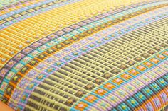 Close up of colourful contemporary handwoven textile design by Angie Parker