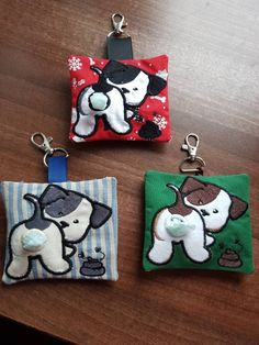 These are fun doggie poop bag holders. They measure approx 4 x 3 1/2. They are machine embroidered with a little hole for the bags so can easily be pulled out. The bag has an envelope backing so the bags can easily be removed. It has a clip on so can be clipped onto a bag, belt coat etc. Please