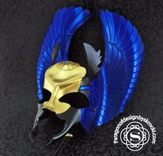 Blue, gold and black Egyptian scarab leather mask.