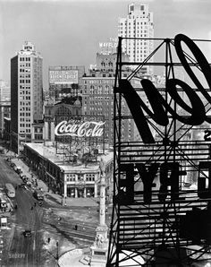 Columbus Circle, Manhattan -- Looking northwest from above the circle, statue of Columbus, B&O bus station topped with Coca-Cola sign, Mayflower Hotel, Central Park with snow, February 10, 1936. Berenice Abbott.