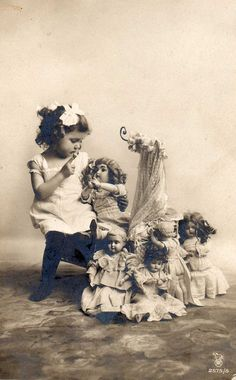 Girl and her dolls