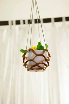Leather hand cut support to hang your plants in or outside home. Only at Doppia VU, Gallarate Italy