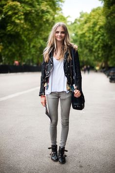 edgy but still relaxed and approachable. love the black leather bomber and the gray skinnies