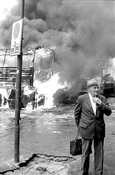 mihai costea. an old man in the street during the riots in post-communist bucharest, 1991.