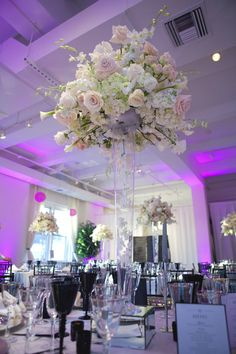 This is almost exactly what we talked about for tall centerpieces, just need to add a few calla lilies!