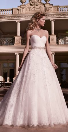 This lovely natural waisted ball gown has three layers on skirt, a tulle beaded layer and two layers of lace-septembers bride