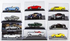 Lot 556: Scale Model Car Assortment; Twelve cars in display boxes including examples from Pauls Model Art Minichamps, 143 Signature Series and James Bond 007