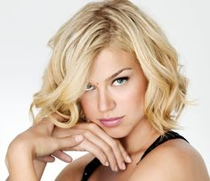 """Consider the uber-trendy long bob (as seen here on actress Adrianne Palicki), which is very flattering on a long face. A long bob with a bit of wave to it is one of my favorite looks for a long face. The bob should end just below the jaw to show off bone structure.   Ask your stylist for an """"A-line Long Bob"""" where the back is about 1 1/2 inches shorter than the front."""