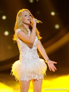 """Hollie was styled in a white Jovani dress, Bebe earrings and a bracelet from PRB private collection for her performance of Pink's """"Perfect"""" at the Top 7 performance show."""