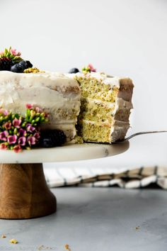 This pistachio cake is made with real pistachios! It's soft, fluffy, light and tastes unbelievable with silky cream cheese frosting. Make this layer cake for your Easter dessert!