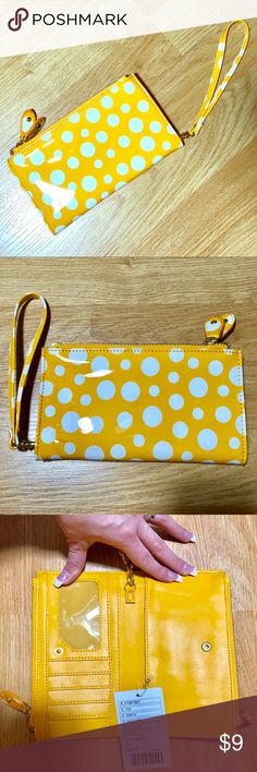 Yellow & white polka dot wallet clutch Yellow & white polka dot wallet clutch  New with tags (NWT) originally $20 never used zippers are in great condition. Zipper area holds a phone perfectly. Small mark is pictured by the wristlet strap on the second photo. Could be cleaned but I don't want to further damage it plus the mark is hardly visible. Two zipper areas. Has 5 slots one for the ID and the rest for cards. Accessories