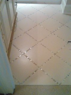 "Lay a thin strip of ""backsplash"" tile in between the large tiles, instead of just using grout..to blend that kitchen backsplach to the floor! ... Unexpected"