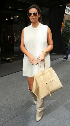 Kim Kardashian, NYC. Celine sweater, celine sunglasses and bracelet, Celine bag, Givenchy boots.