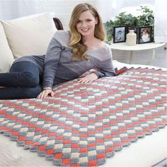 Take a trip with the Around The World Tunisian Throw! Cute little squares are worked in rounds to achieve this great woven look. Try this Tunisian crochet blanket pattern in bright colors or neutrals and you'll still love the result.