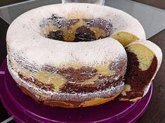 Zutaten: -220 g Zucker -1 Pck. Vanillinzucker -4 Eier -150 g Margarine -300 g Mehl -1 Pck. Backpulver -1 Becher Schmand oder Naturjoghurt -2 EL Kakaopulver -Fett für die Form -Paniermehl für die Form...