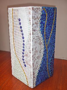 Tall blue and white glass mosaic plant pot by Laura Leon Mosaics, via Flickr