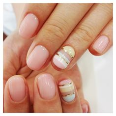 + One nail with nail art Light Opaque Pink and metallic silver, pastel: pink, white, blue &yellow