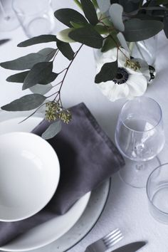 White poppies for a modern black and white tablescape look. Add white LED candles by Mirage to complete it.