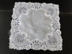 We buy and sell fine antique linens, antique lace, textiles, haute couture design, antique clothing, Chinese, European textiles, Canton shawls, antique accessories, Brussels lace, wedding veils, antique children's clothing, vintage clothing, Margab linens. We are located in the New York Metropolitan area.
