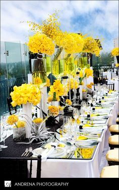 Stunning yellow reception table setting.