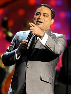 """Gilberto Santa Rosa - No one sings boleros like Gilberto! The Puerto Rican singer was part of the Puerto Rican All Stars back in the 1980's. Once he went solo, he produced hits including, """"Vivir Sin Ella"""" and """"Punto de Vista."""" Since 2010, he also held the record for having the most number one hits on the Billboard Latin charts."""