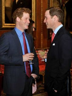 Britain's Prince William (R) talks with brother Prince Harry (L) during a reception in the Waterloo Chamber, before Queen Elizabeth II's Sovereign Monarchs Jubilee lunch at Windsor Castle, west of London, on May 18, 2012.