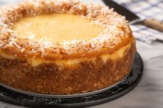 This Coconut Cheesecake Tastes Like a Tropical Vacation A combination of cream of coconut and shredded coconut gives this beautiful cheesecake its strong tropical flavor. Sour Cream Coconut Cake, Coconut Frosting, Coconut Desserts, Coconut Custard, Coconut Macaroons, Coconut Cakes, Lemon Cakes, Coconut Oil, Toasted Coconut