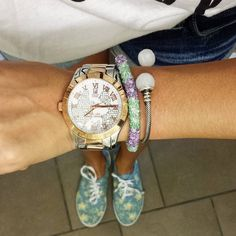 Arm candy and floral shoes