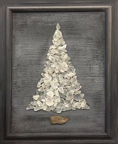 White beach sea glass tree on charcoal gray background, set in vintage charcoal frame. Tree base is driftwood. With it's cool gray and fresh white colors, this tree was made to be left out all year long; colors are soothing, relaxing to look at.   I cannot make these fast enough during the fall months. I've been commissioned to make many as gifts. I generally only make 4-5 originals per year, before running out of both glass and patience. In 2013, after depleting my green glass supply…