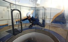 A member of staff demonstrates the RipCord by iFLY skydiving simulator at the back of Quantum of the Seas