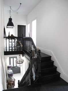 The Best 24 Painted Stairs Ideas for Your New Home Really cool stairs with an industrial workspace.reminds me of my sisters house. cool stairs with an industrial workspace.reminds me of my sisters house. Black Staircase, Staircase Design, Black Banister, Black Painted Stairs, Stair Design, Modern Staircase, Industrial Workspace, Industrial Stairs, Industrial Lamps