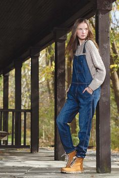 Current/Elliott's cotton denim overalls and Chinti and Parker's cashmere sweater. K/ller Collection jewelry; Timberland boots. [Photo by George Chinsee]