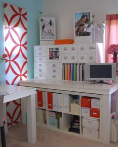 "It's true -- a room this beautiful can be created on a budget! Mommy2malia purchased the counter-height tables from a store liquidation sale and found floating shelves at a local garage sale. Inspired by the signature Martha Stewart blue, she chose a similar shade to accent one wall. What's her organizing secret? ""I made sure I'd be able to have enough space to display what I wanted to see and hide what I didn't."""
