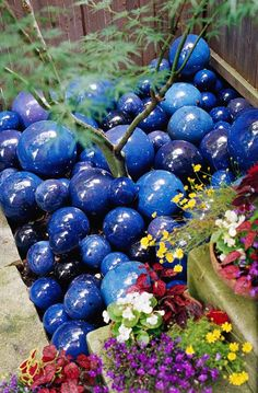 "Embrace the Unexpected; mulch doesn't always have to be chopped-up wood -- especially in small spaces. Here, a ""mulch"" of blue glazed ceramic balls brightens up the base of a Japanese maple. Garden Crafts, Garden Projects, Garden Ideas, Garden Globes, Unique Gardens, Unique Garden Decor, Yard Art, Garden Inspiration, Garden Landscaping"