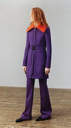 Victoria offset this purple coat and trousers with a bright orange collar