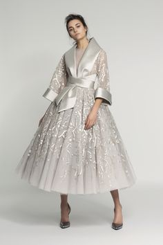 "Japan, cherry blossom and a reworking of the kimono provided inspiration for the extravagant sculptural shapes that sparkled with beaded blooms. ""We worked more on the inside than the outside with ..."