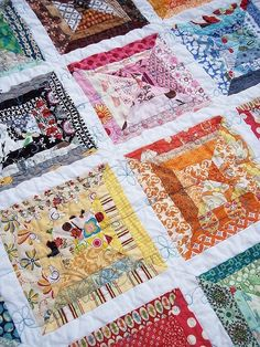 scrap quilt with white strips