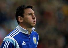 Argentina's forward Lionel Messi gestures during his warm up during a friendly football match against Slovenia at La Plata stadium in La Plata, Buenos Aires, Argentina on June 7, 2014 in preparation of the 2014 FIFA World Cup Brazil to be held between June 12 and July 13.