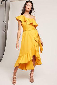 2bc9ac941c A woven maxi dress featuring a ruffle trim creating the short sleeve