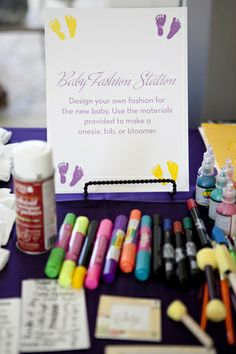 Decorate bibs with a baby fashion station {Photo by Andrea Taylor Studio} #babyshowers