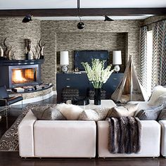 Love the feeling of comfort in this room. Maybe a semi dark gray couch instead of white due to my dogs.