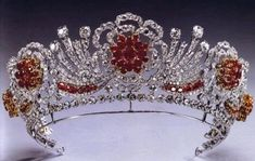 The Burmese Ruby Tiara was created by Garrard in 1973 per request of Queen Elizabeth II. The tiara was made from some of her wedding presents; rubies from Burma and diamonds taken from the Hizam of Hyderabad Tiara. British Crown Jewels, Royal Crown Jewels, Royal Crowns, Royal Tiaras, Royal Jewelry, Ruby Jewelry, Tiaras And Crowns, Jewelery, Silver Jewelry