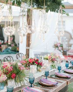 An Island-Inspired, Backyard Wedding Anniversary Dinner | Martha Stewart Weddings - Hmong textile napkins and tropical flowers gave pops of color against the wooden, copper, and candlelit elements of the table.