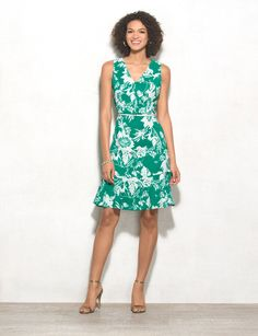 Give your wardrobe and fresh and feminine update with a bright floral dress. A ruffled hem adds an even flirtier touch. Allover green and white floral print. Imported.