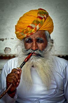 Smoking a pipe - India